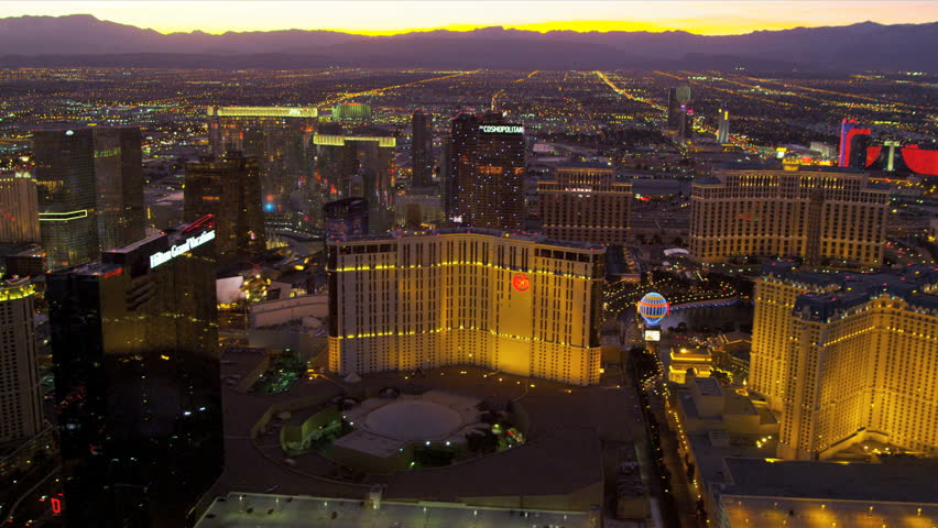 Las Vegas - January 2013: Aerial view sunset Las Vegas illuminated city Hotels and Casinos, Las Vegas, Nevada, USA, RED EPIC | Shutterstock HD Video #4243286