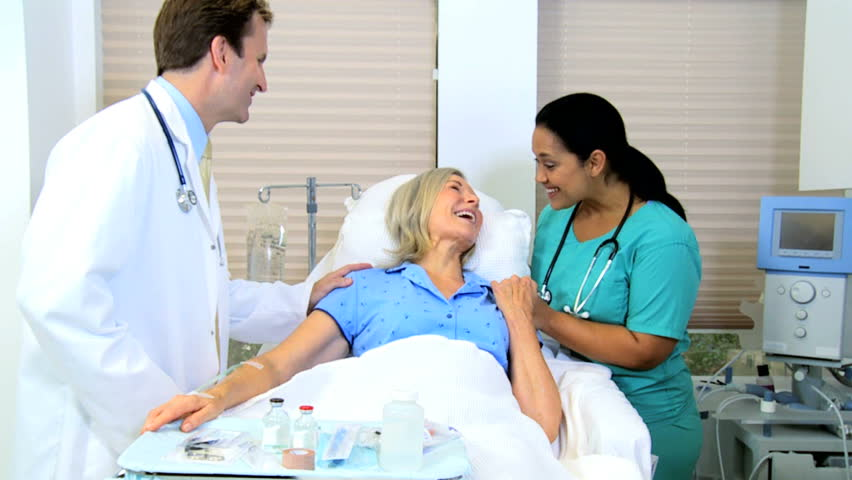Hospital consultant nurse giving medical care to senior retired female patient #4312562