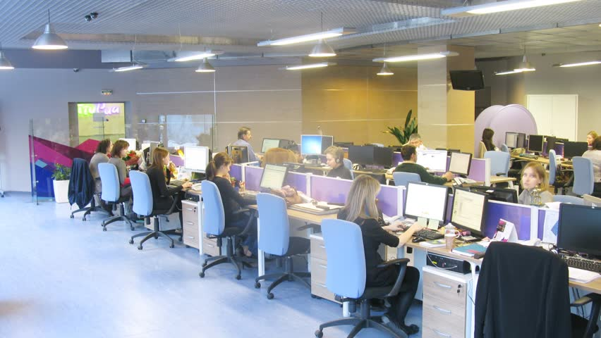 MOSCOW - MAR 05: (timelapse) People working at their desk at RIA Novosti, on Mar 05, 2013 in Moscow,. Russia.