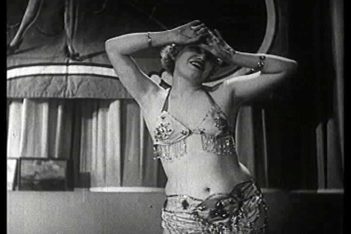 1930s - Famous dancers of the burlesque stage exhibit their strippers in a 1930s stag film.