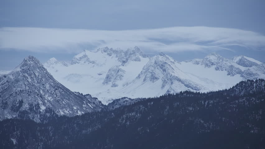 Cloud time lapse of the snowy peaks of the Kenai Mountains over Kachemak Bay,