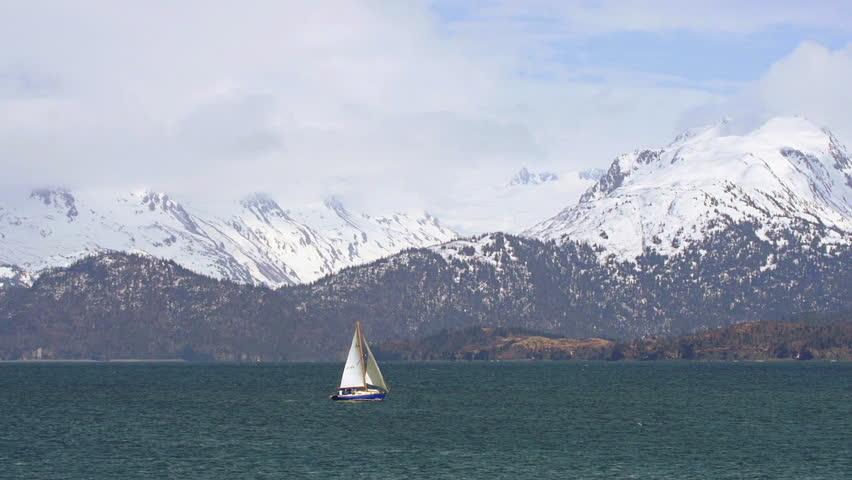 A sloop under way on Kachemak Bay, Alaska in springtime