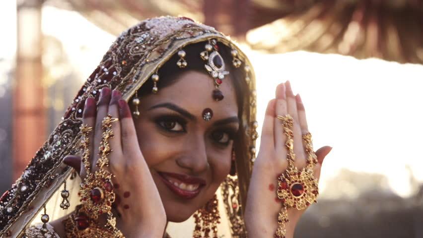 Shot of a happy Indian bride posing