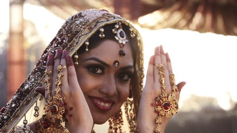 Shot of a happy Indian bride posing