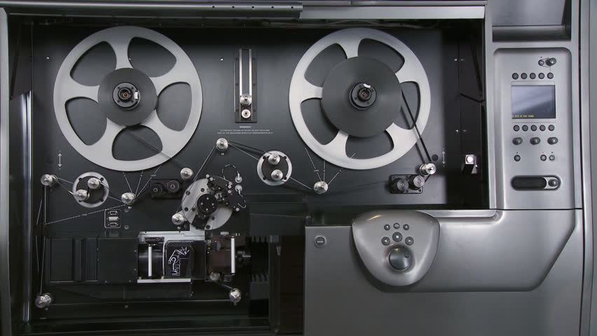 Telecine machine scanning and digitizing a 35mm film print in a movie