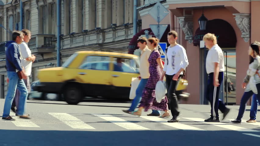 ST. PETERSBURG, RUSSIA - JULY 27: Pedestrians crossing at a pedestrian crossing the roadway on July 27, 2013 in St. Petersburg, Russia.