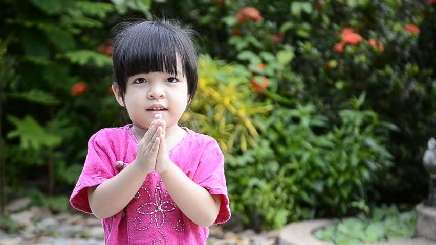cute asian baby girl in action salute with hand of thailand