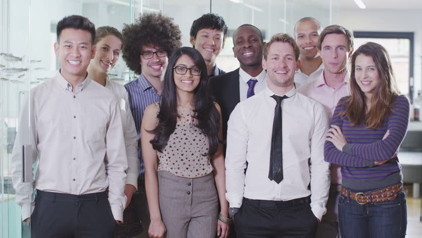 Portrait of a happy and casual young creative business team smiling and having fun together. In slow motion. | Shutterstock HD Video #4389032