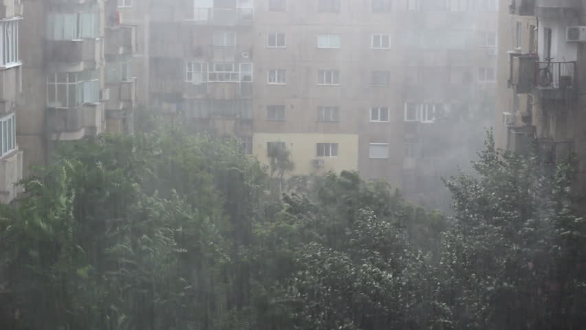 Extremely powerful storm hitting an European capital. Such storms started hitting Europe for the first time in 2013, devastating and flooding big cities. Sound included.