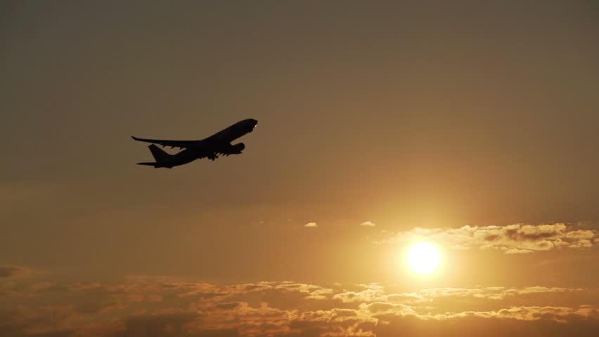 Airplane take off at sunset