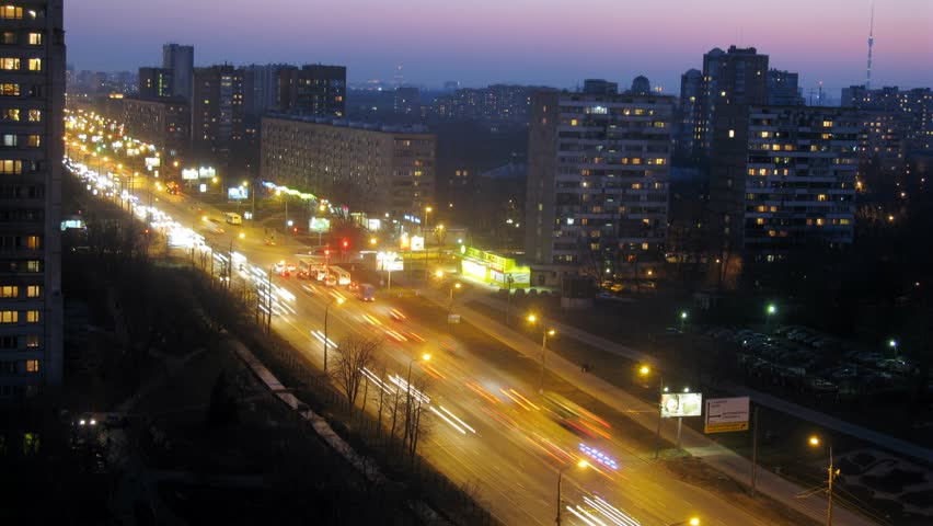Illuminated highway with traffic during the night, timelapse