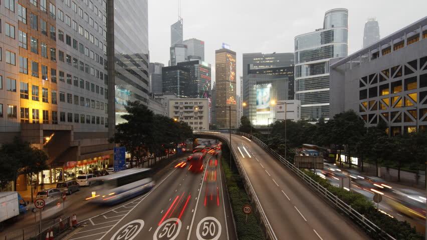 Hong Kong landmark and city traffic at night - 4K