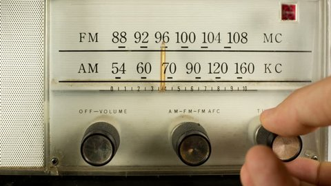 close up of a vintage radio dial with the stations and frequencies being tuned