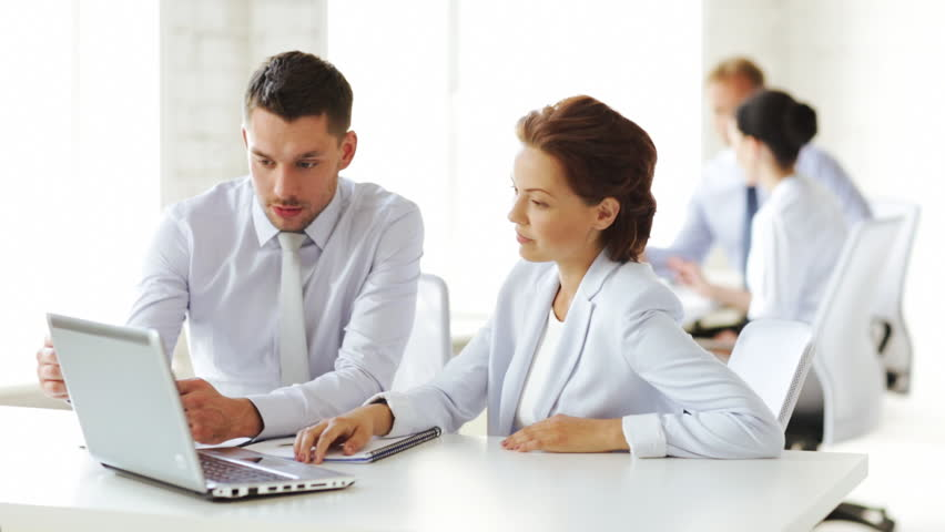 Group of business people having a meeting | Shutterstock HD Video #4431002
