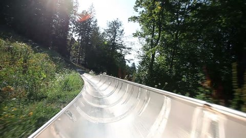Young man is driving with camera in bobsled pov