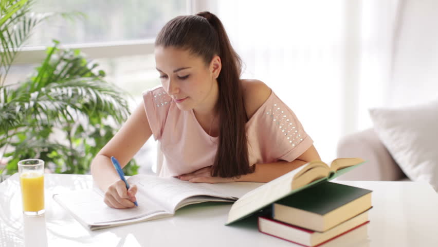 Stock video of student girl sitting at table writing 4464002 stock video of student girl sitting at table writing 4464002 shutterstock publicscrutiny Gallery