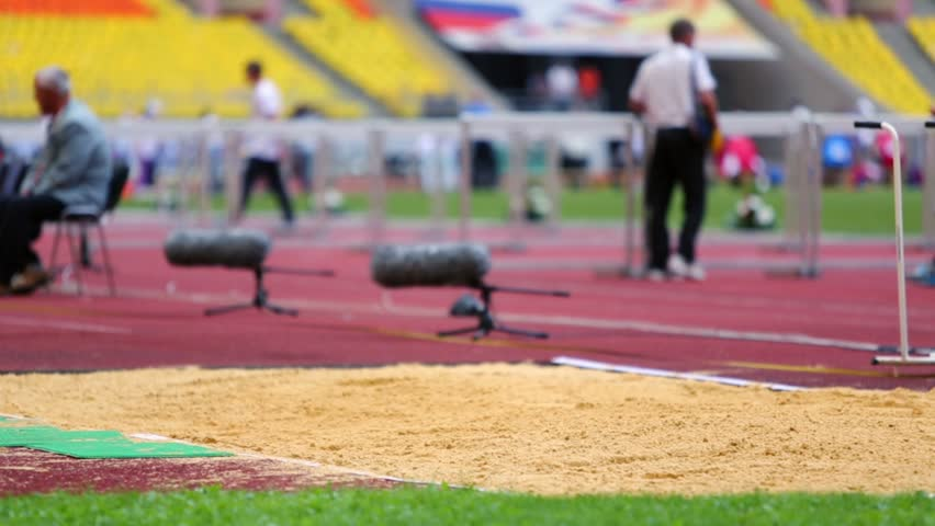 MOSCOW - JUN 11: Sportswoman does length jump to sandpit at Grand Sports Arena of Luzhniki OC during international athletics competitions IAAF World Challenge on 11 June 2012, Moscow, Russia.