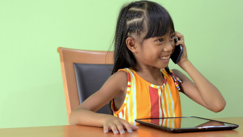 Young Asian Girl Answers Her Stock Footage Video (100% Royalty-free)  4470392 | Shutterstock