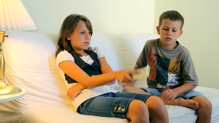 Image result for siblings fighting for remote