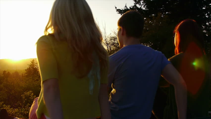Close-Up Of 3 Teen Friends Enjoying The Sunset