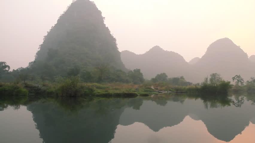 Dragon(Yulong) river Sunrise, shooting on bamboo raft. - Yangshuo Guilin,