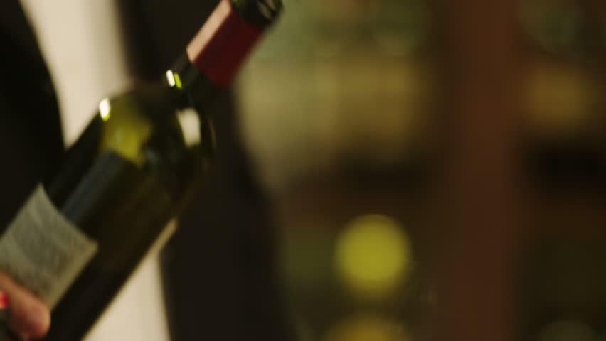 Sommelier Filling Glass with Wine in Restaurant. Close-UP. Shot on RED Digital Cinema Camera in 4K (ultra-high definition (UHD)), so you can easily crop, rotate and zoom, without losing quality!