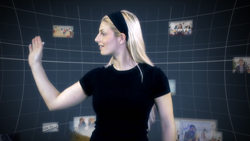 Futuristic business woman interacting with technology and media around her