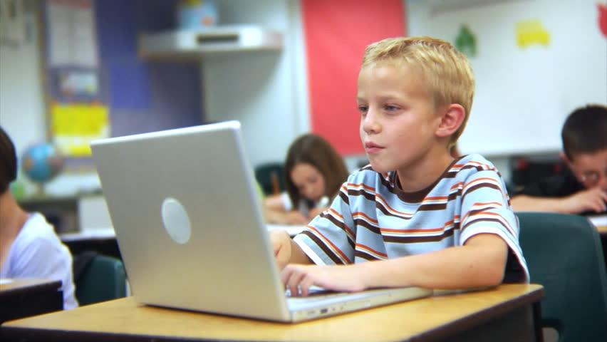 School student working on laptop computer