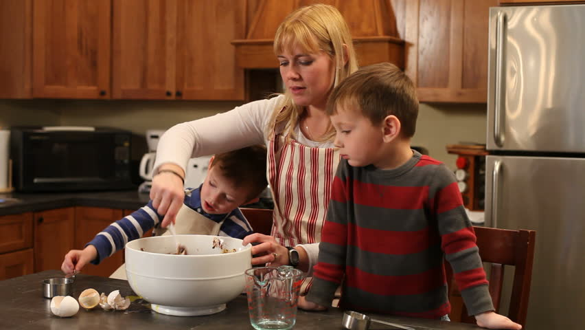 Children helping Mom in kitchen