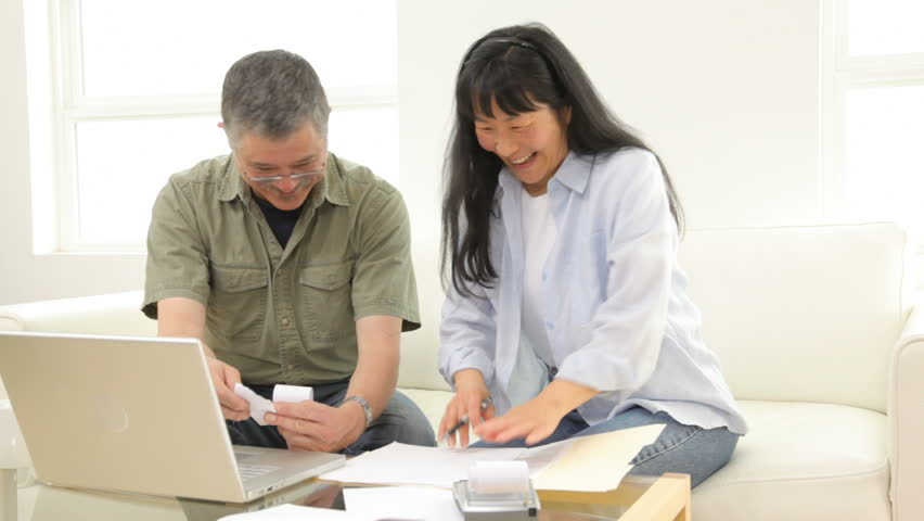 Mature Asian couple working on personal finances