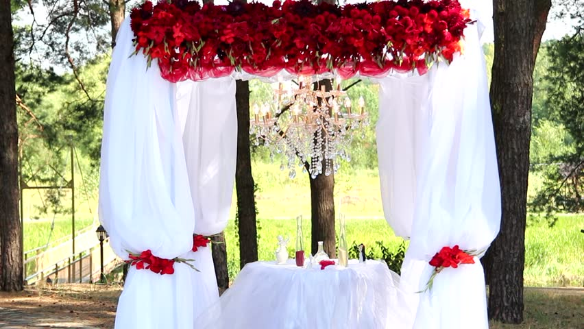 Outdoor wedding setting for celebration of becoming family wedding outdoor wedding setting floral decorations for wedding ceremony details of decor close junglespirit Gallery