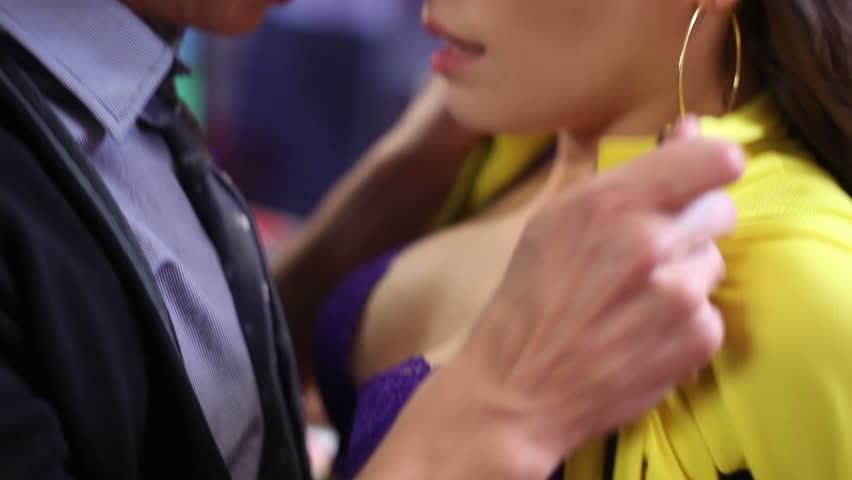 Young couple romantic kissing. Passionate flirt. Man rips girl skirt and kisses