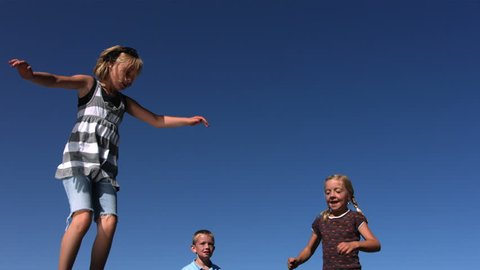 Kids jumping on trampoline, slow motion