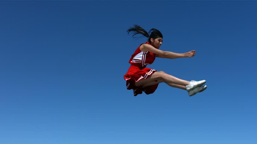 Cheerleader performs aerial stunt , slow motion #4578992