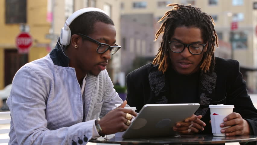 Friends looking at digital tablet together