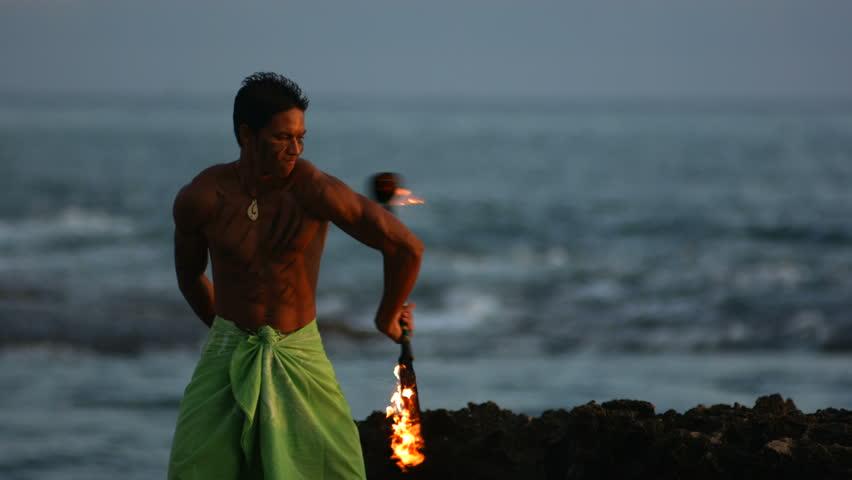 Hawaiian fire knife dancer performs, slow motion