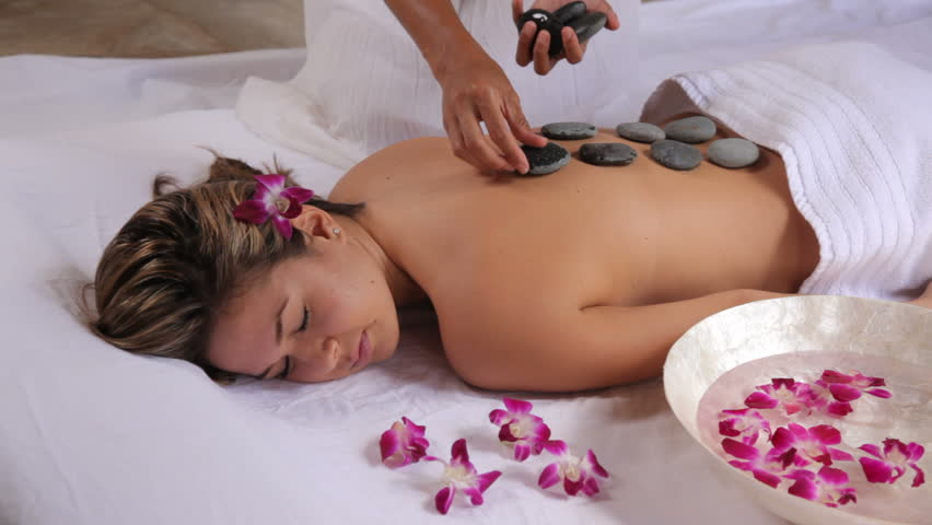 Video Stock A Tema Woman Gets Hot Stone Spa 100 Royalty Free 4595702 Shutterstock