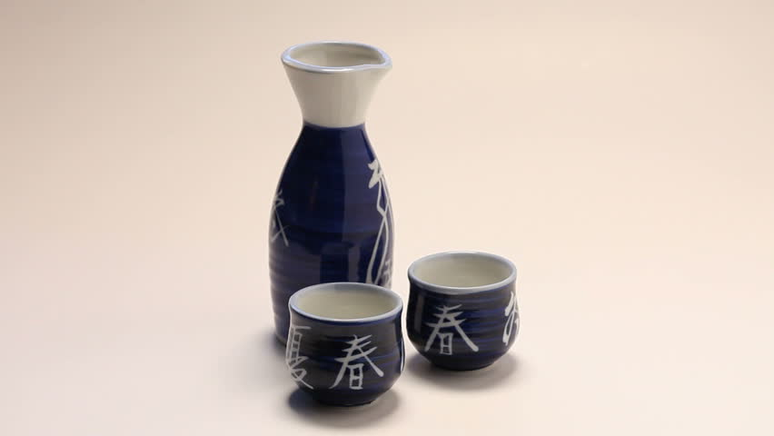 Sake pouring into cup.