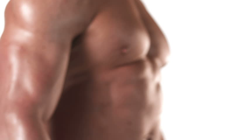 Close up shot of a muscular bodybuilder flexing his large muscles on a white background