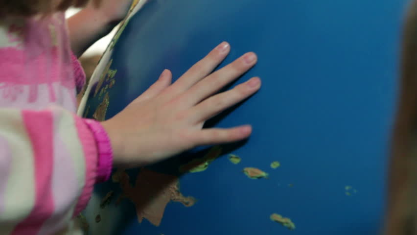 Close Up Of Kids Pointing Out On Earth Globe Map Stock Footage - Map videos for kids
