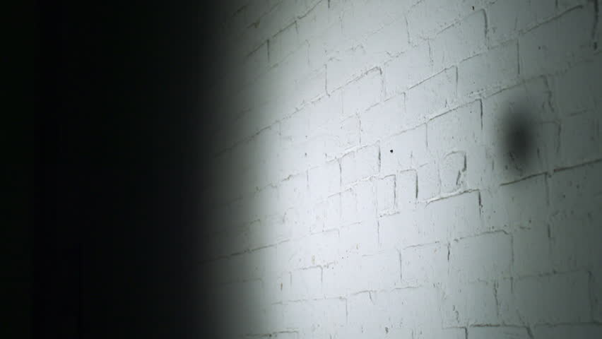 Smashing empty glass bottle on brick wall shooting with high speed camera, phantom flex.