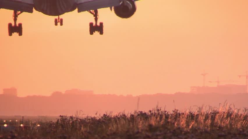Huge Airplane landing at sunrise