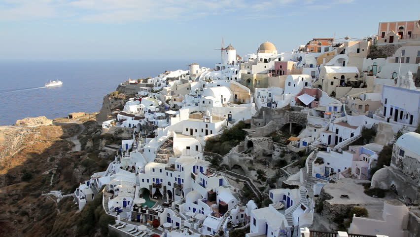 The white washed homes in the town of Oia with a view overlooking the  Aegean Sea