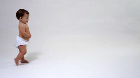 Toddler walking against white background