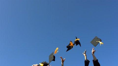 Throwing graduation caps, slow motion