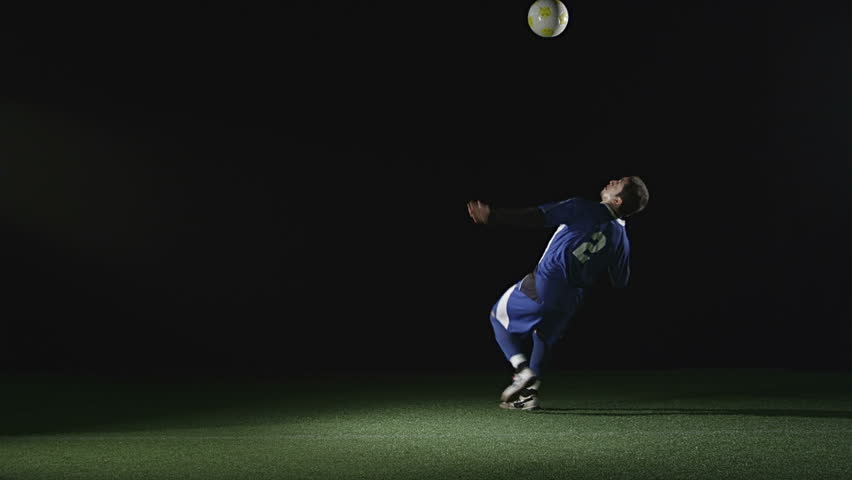 A very good soccer player catches a ball with his chest and then jumps in the air and kicks the ball. Wide slow motion shot. | Shutterstock HD Video #4650632
