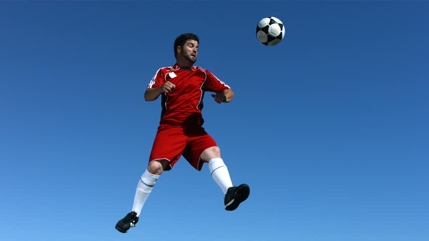Soccer player jumps in the sky, slow motion #4654442