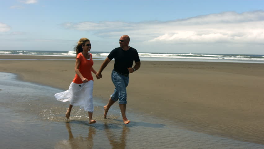 Couple run on beach together, slow motion | Shutterstock HD Video #4656782