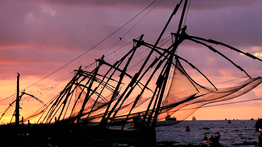 Chinese fishing nets at sun set Fort Kochi, Cochin, Kerala India