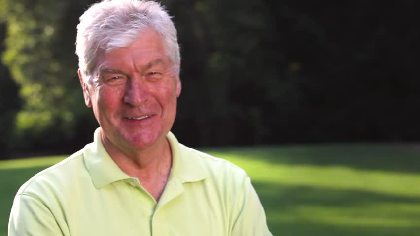 Portrait of an older male in a park. Medium shot. | Shutterstock HD Video #4665962